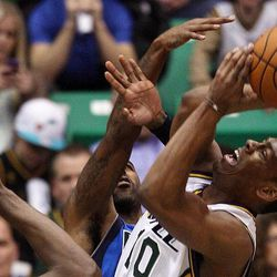 Alec Burks of the Utah Jazz is fouled as he goes up for shot against Dallas during NBA basketball in Salt Lake City, Monday, Jan. 7, 2013.