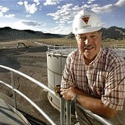 Sid Jansma, president and CEO of Wolverine Gas and Oil, stands atop a 10,000-barrel storage tank. The oil strike is living up to its promise.