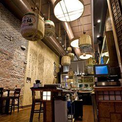 Sake barrels hang from the ceiling