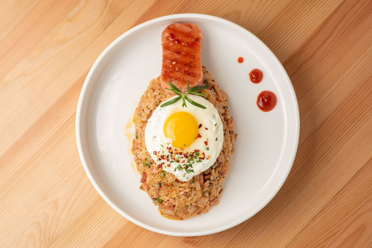 A creative plate of Spam fried rice with sunny-side egg on top.