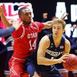 Utah Utes forward Dakarai Tucker (14) guards Brigham Young Cougars guard Chase Fischer (1) as Utah and BYU play in the Huntsman Center in Salt Lake City Wednesday, Dec. 2, 2015. Utah won 83-75.
