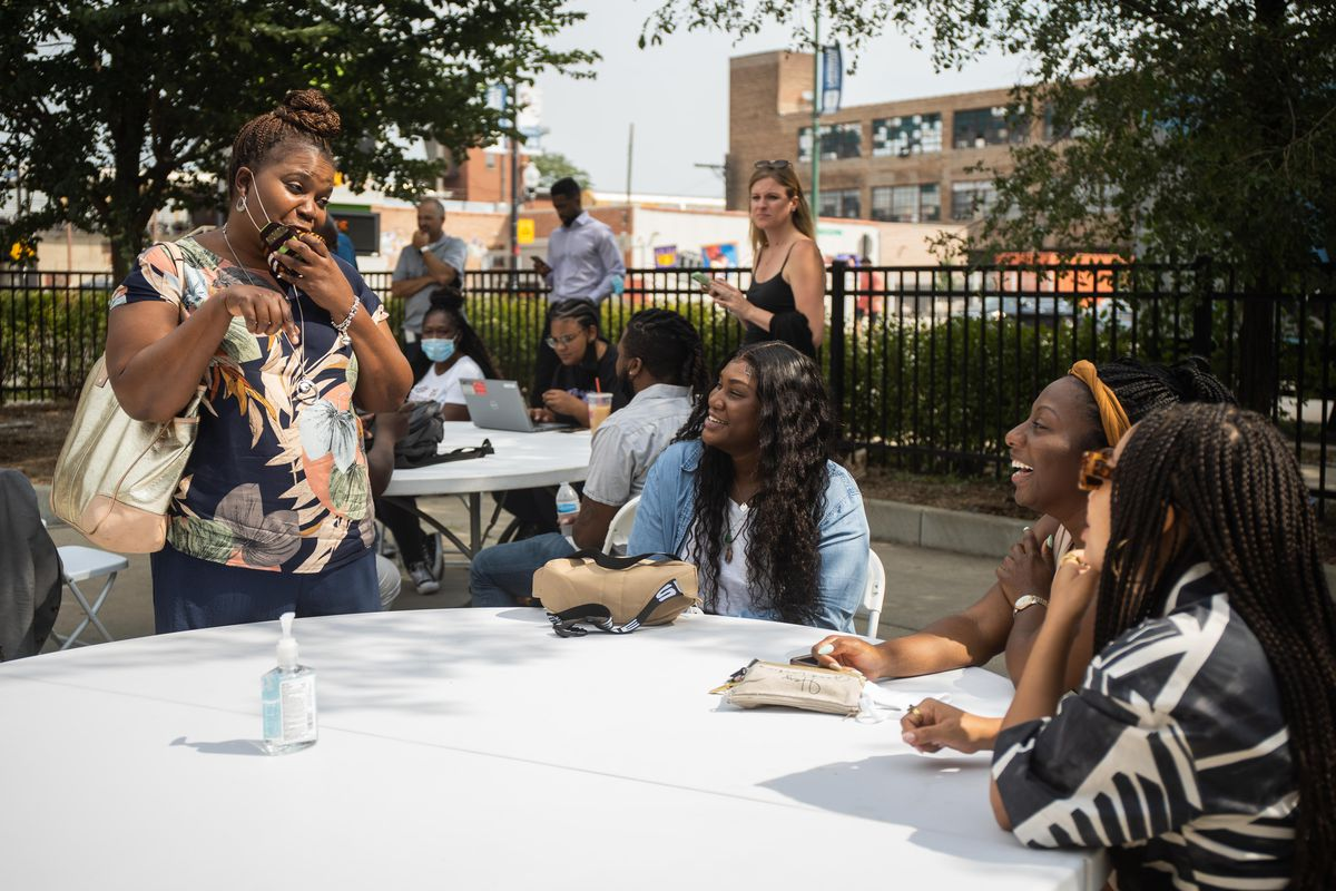 Yolanda Fields (from left), executive director at Breakthrough, speaks Tuesday to Lawndale Christian Legal Center employees Diamond Texas, Carli Taylor and Asha Grayson. They were chatting after a news conference to announce that the legal center will provide attorneys to three nonprofit social service agencies through a new coalition, Justice Rising: Project 77.