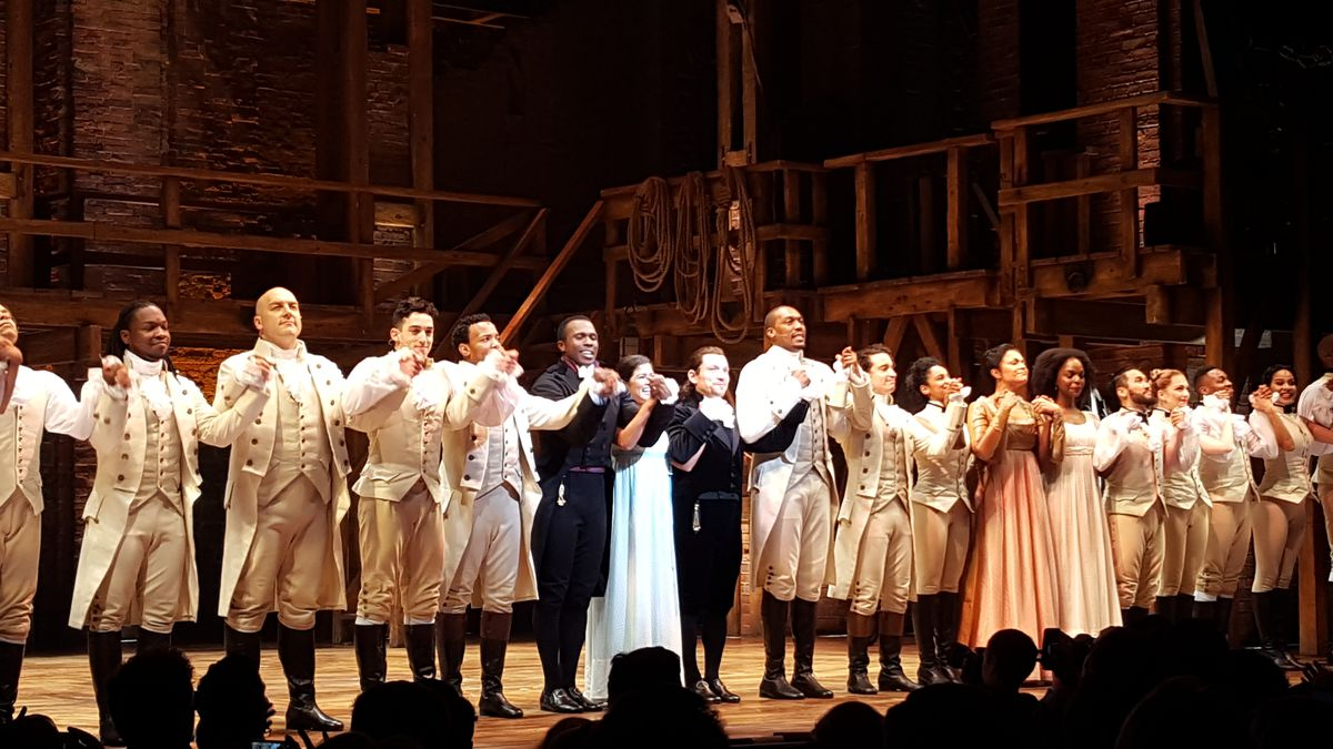 """The cast of """"Hamilton"""" receives a standing ovation during the opening night curtain call at Chicago's PrivateBank Theatre.   MIRIAM DI NUNZIO PHOTO"""