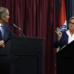 Democratic Sen. Claire McCaskill, right, speaks as Republican challenger Rep. Todd Akin listens during the first debate in the Missouri Senate race Friday, Sept. 21, 2012, in Columbia, Mo.