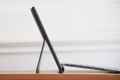 The Asus Chromebook Detachable CM3 open from the right side.