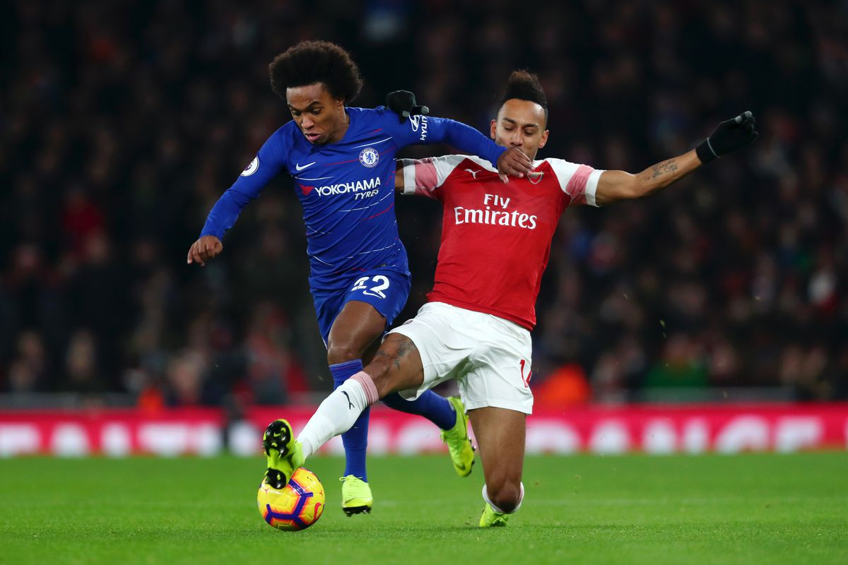 Willian of Chelsea is challenged by Arsenal's Pierre-Emerick Aubameyang - Arsenal FC v Chelsea FC - Premier League
