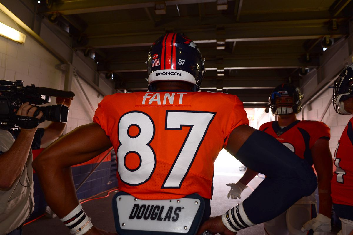 Denver Broncos tight end Noah Fant waits to warm up before a game against the Chicago Bears at Empower Field at Mile High.