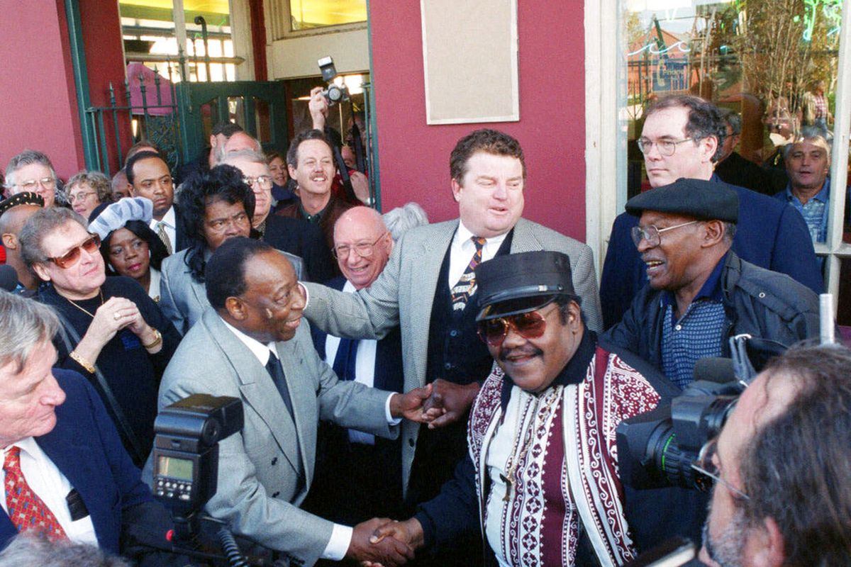 Dave Bartholomew and Fats Domino shake hands in New Orleans