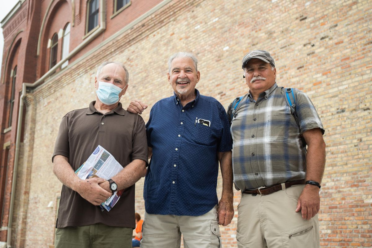 Friends James Kinney, Tom Shepherd and Wayne Garritano pose for a picture outside the Pullman National Monument's visitor's center on its opening day in the Pullman neighborhood, Saturday afternoon, Sept. 4, 2021.
