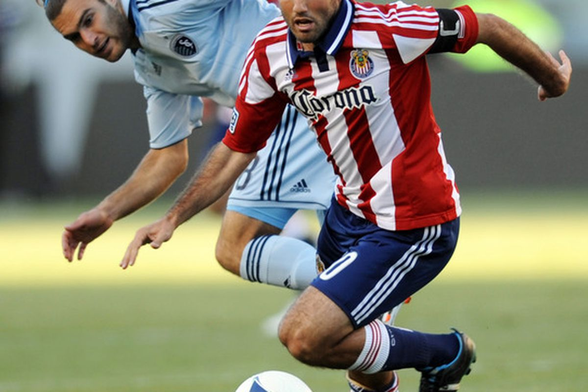 Apr 1, 2012; Carson, CA, USA; Zusi got the job done for SKC Sunday, while LaBrocca was close (but no cigar) for Chivas. Mandatory Credit: Kelvin Kuo-US PRESSWIRE