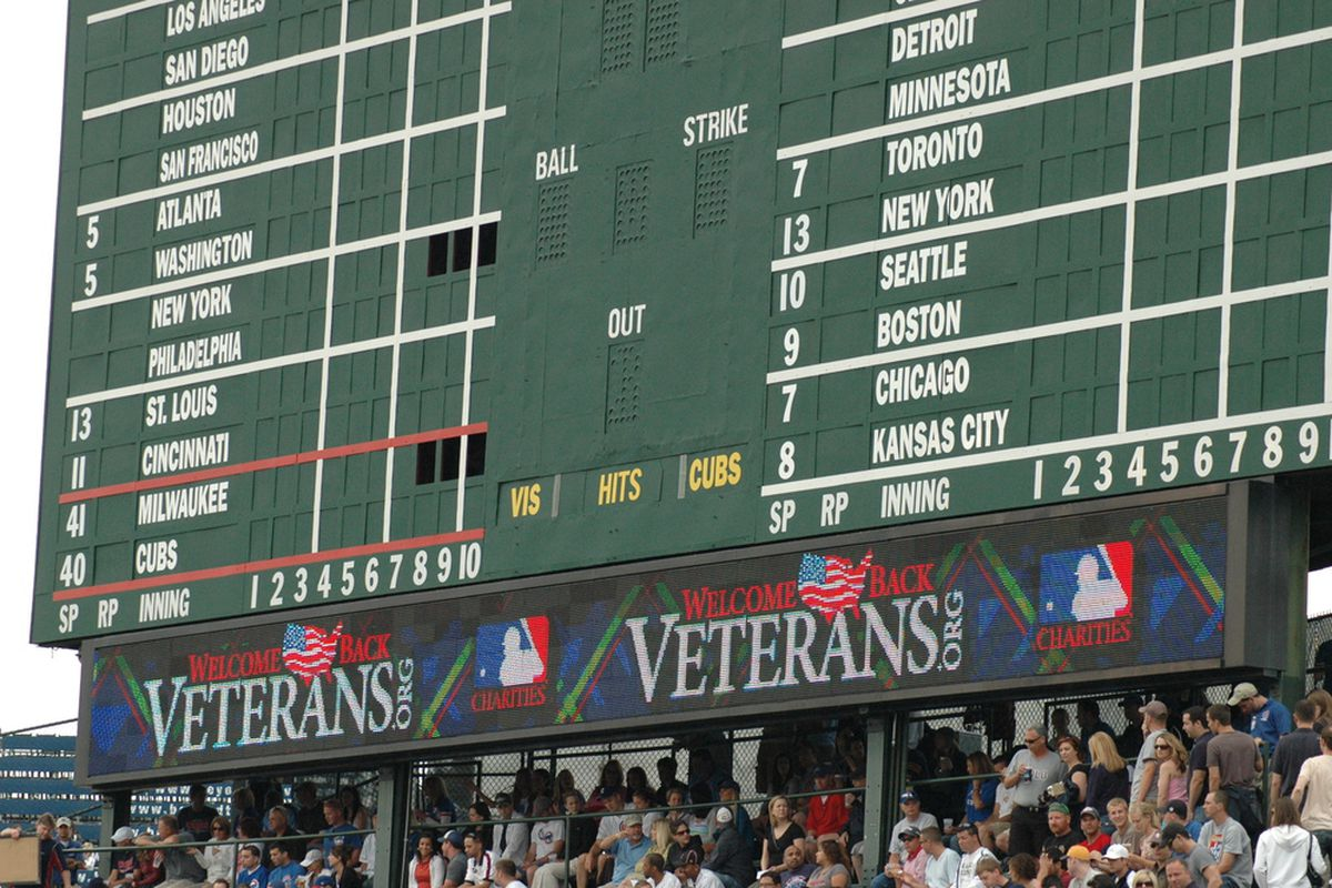 The Cubs salute veterans on the scoreboard before Saturday's game. <em>(BCB Photo by David Sameshima)</em>