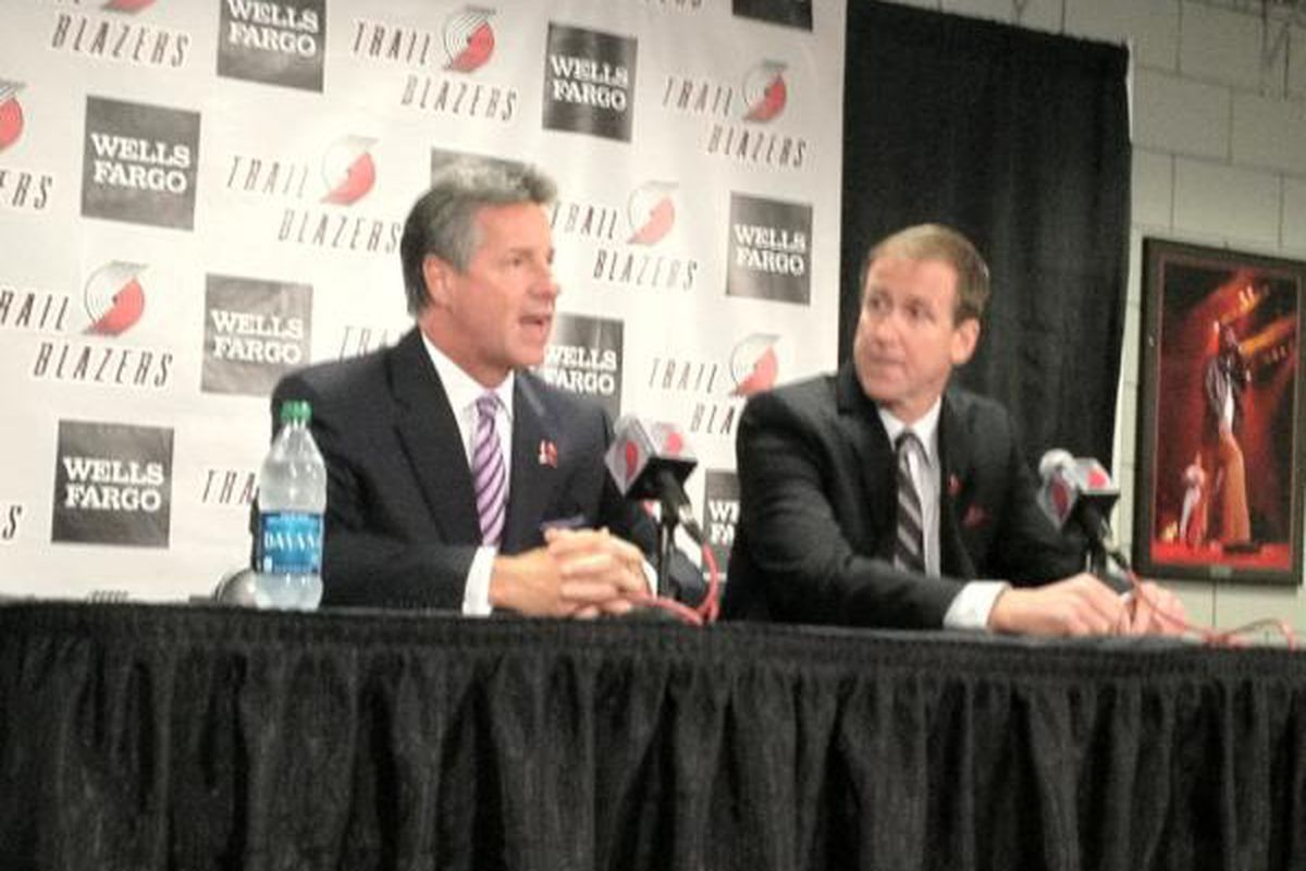 Blazers GM Neil Olshey introduces coach Terry Stotts at the Rose Garden on Wednesday.