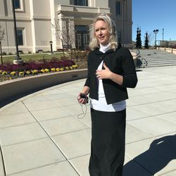 Becki Bronson, a longtime resident of Cedar City, speaks with reporters in front of the Cedar City Temple Monday.