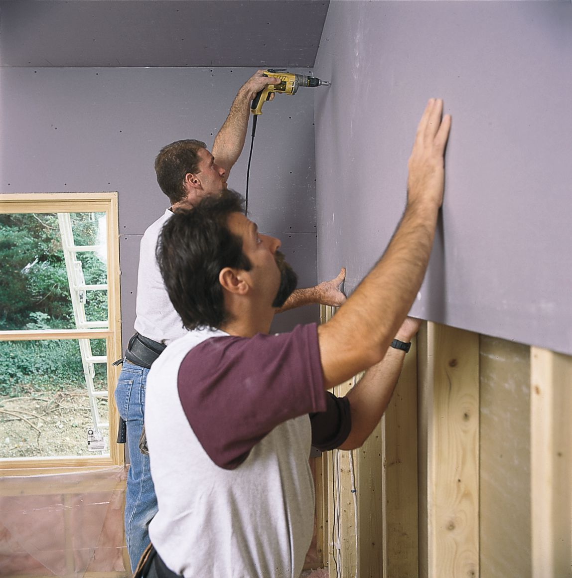 Men Cover The Wall With Drywall