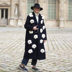 Anya Hindmarch coat and slip-on sneakers in Paris.