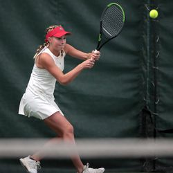 Woods Cross High School's Sage Bergeson hits a return as she and Highland's Dylan Lolofie battle for the 5A tennis state championship at Salt Lake Tennis & Health Club on Saturday, Oct. 9, 2021.