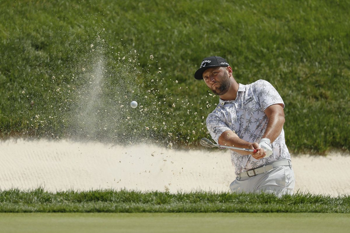 Jon Rahm hits onto the 9th green during the third round of the Memorial Tournament at Muirfield Village Golf Club in Dublin, Ohio on Saturday, June 5, 2021.
