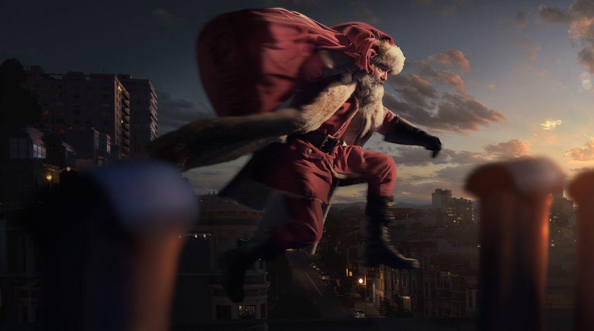 Kurt Russell, as Santa, leaps over chimneys.