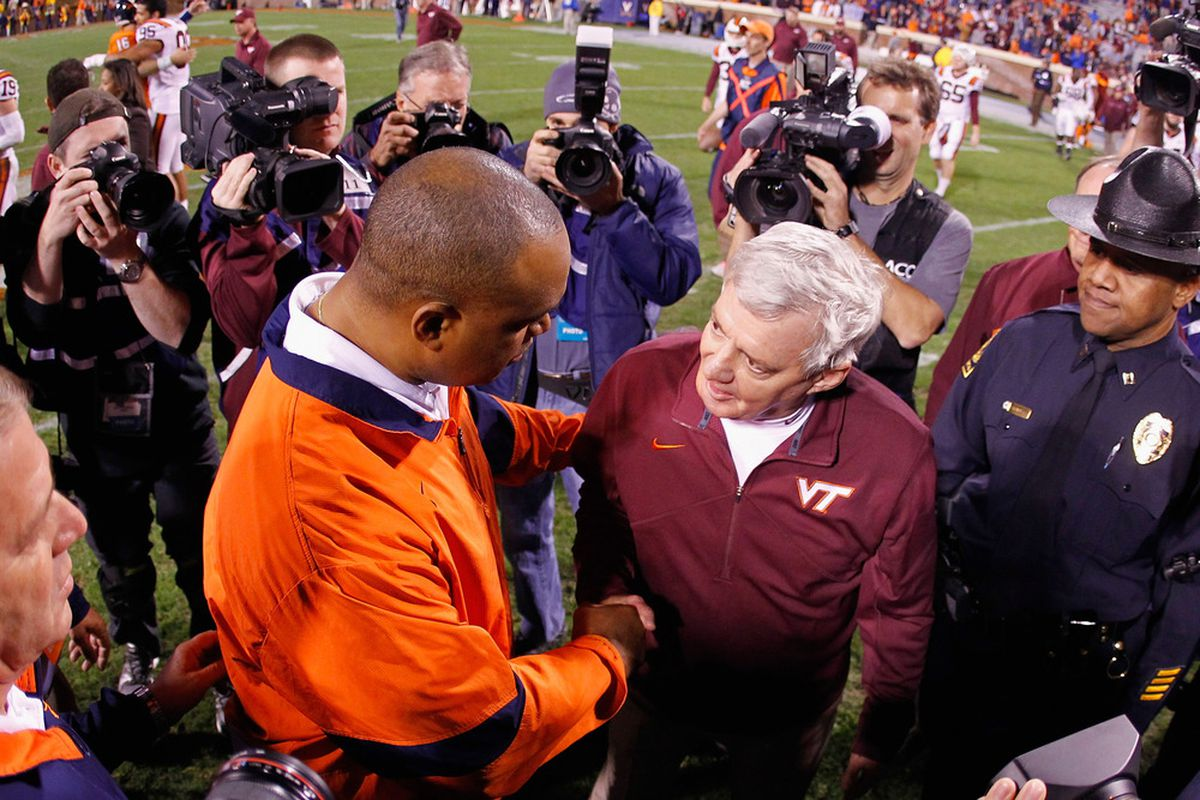 Mike London and Frank Beamer will go to war over Virginia's deep talent pool in the 2014 class. (Photo by Geoff Burke/Getty Images)
