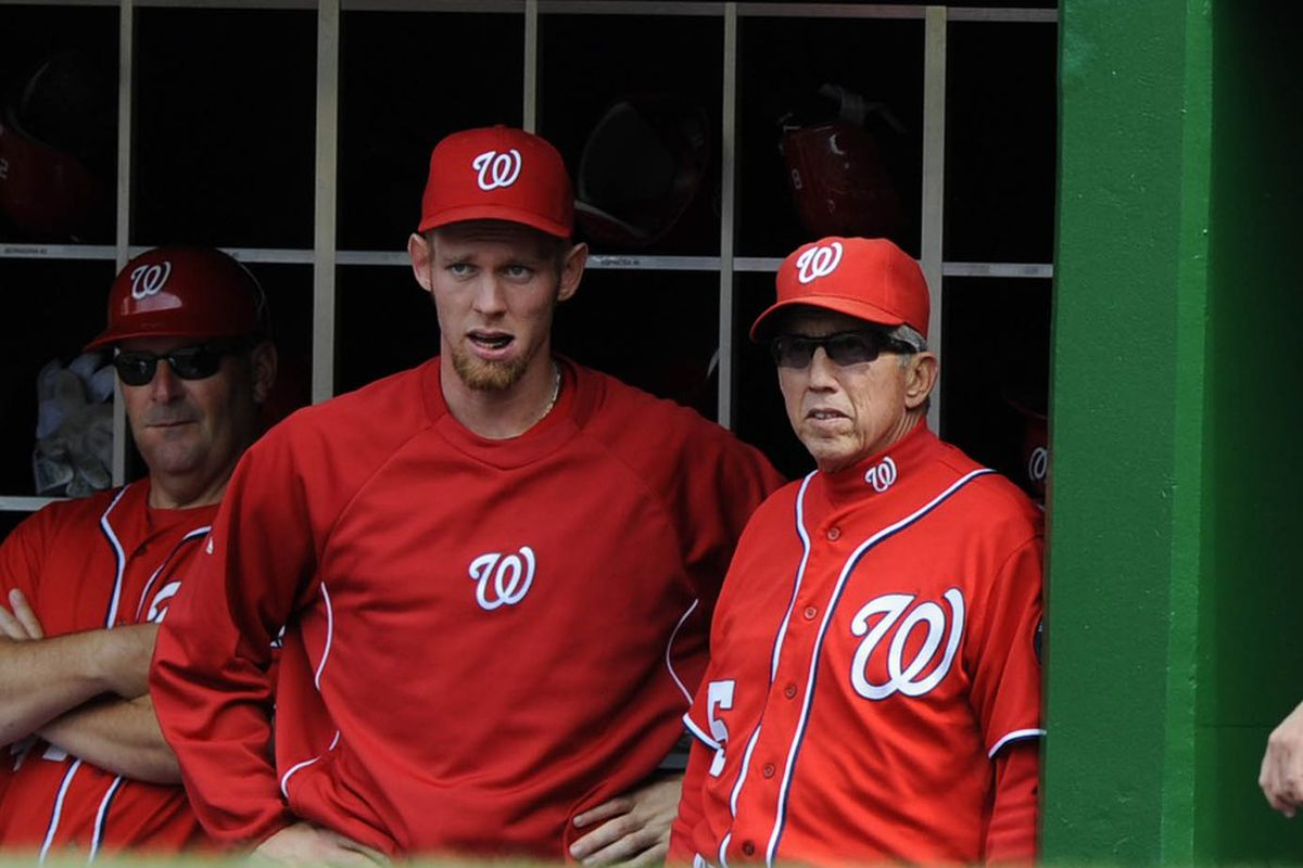 Steven Strasburg and Davey Johnson talk during a May 2012 game against the Baltimore Orioles.
