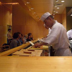 """<a href=""""http://ny.eater.com/archives/2012/08/10_nyc_sushi_omakases_to_have_before_you_die.php"""">12 Excellent Sushi Omakases</a>"""