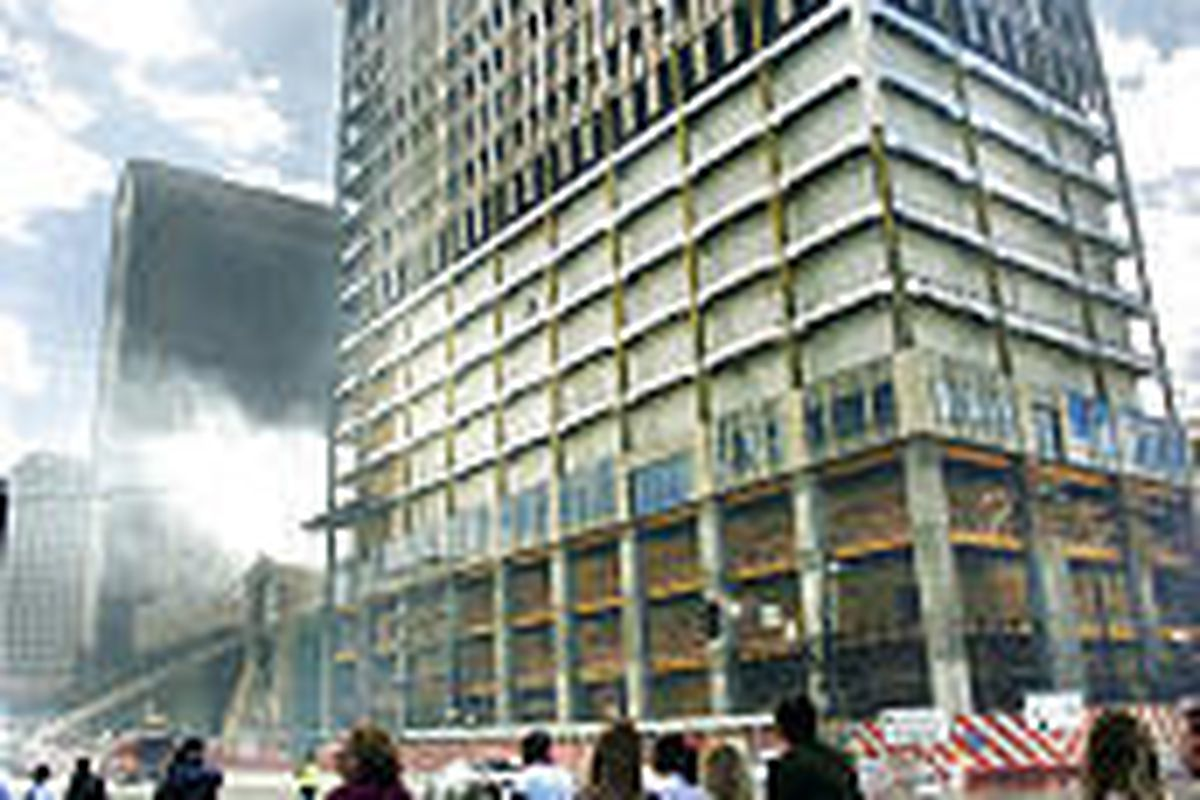 Downtown shoppers watch as crews battle three-alarm fire Saturday at the ZCMI Center.