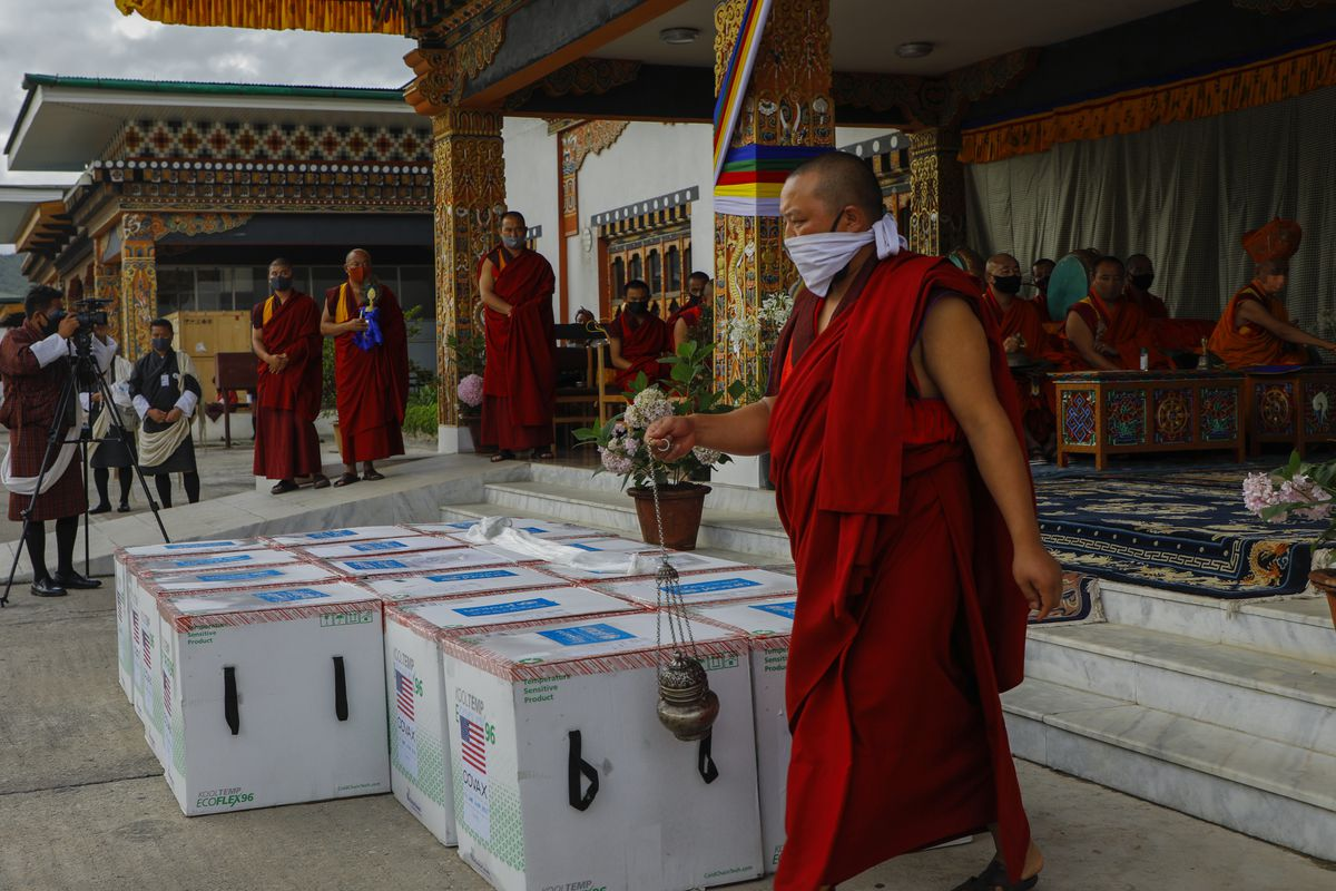 Monks from Paro's monastic body perform a ritual as 500,000 doses of Moderna COVID-19 vaccine gifted from the United States arrived at Paro International Airport in Bhutan
