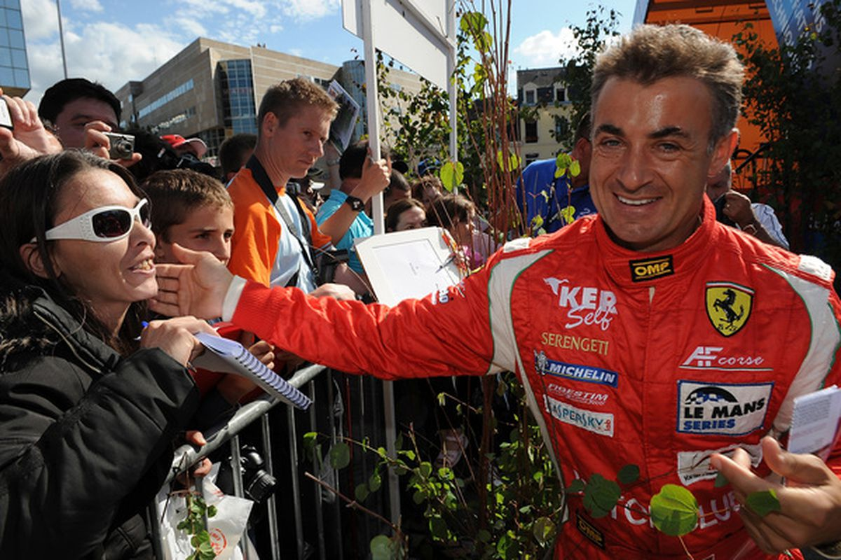 LE MANS, FRANCE - JUNE 06:  Jean Alesi of France and driver of the # 95 AF Corse Ferrari 430 GT greets fans during scrutineering for the 78th running of the Le Mans 24 Hour race June 6,  2010 in Le Mans, France  (Photo by Rick Dole/Getty Images)