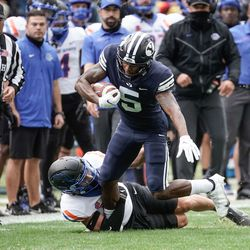 BYU wide receiver Chris Jackson (5) gets tackled by Boise State cornerback Kaonohi Kaniho during an NCAA college football game at LaVell Edwards Stadium in Provo on Saturday, Oct. 9, 2021.