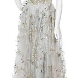 It looks like little fairies embroidered this George Halley lace ball gown, no? Its estimated cost is $300 to $500.