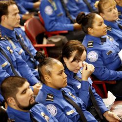 A TSA officer wipes her eyes during the public memorial service for TSA officer Gerardo Hernandez, Tuesday, Nov. 12, 2013. Hernandez was the first TSA officer killed in the line of duty when a gunman pulled a rifle from a bag and shot the 39-year-old father of two on Nov. 1, at Los Angeles International Airport. Two TSA officers and a teacher were injured before airport police wounded the gunman, Paul Ciancia.