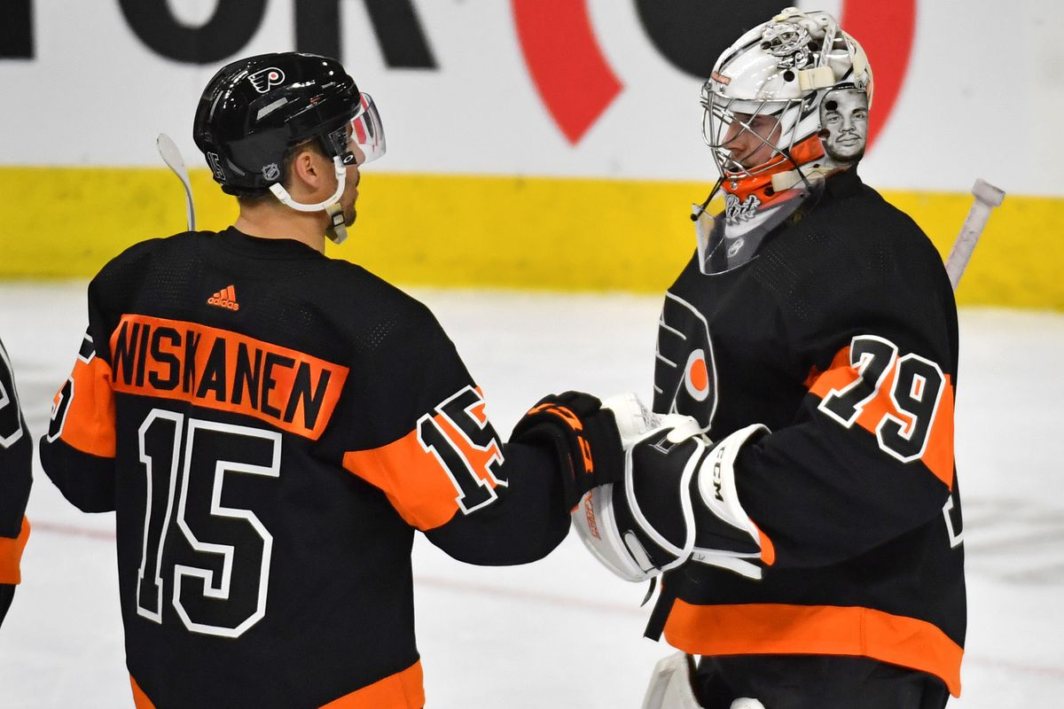 Philadelphia Flyers defenseman Matt Niskanen and goaltender Carter Hart celebrate after defeating the New York Rangers at Wells Fargo Center.
