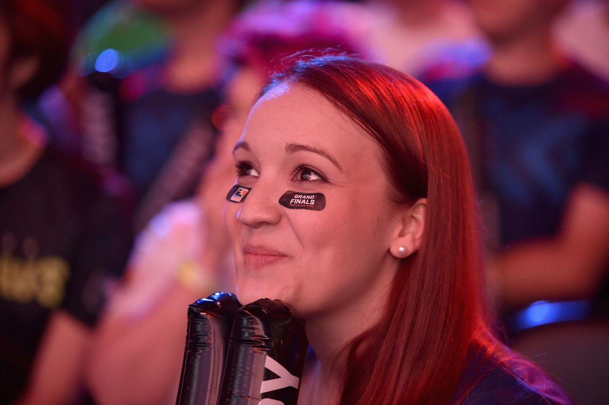 A female fan watches the Overwatch League Grand Finals