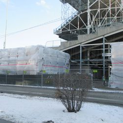 The two left field corner structures, under construction and under wraps