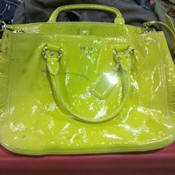 Someone is going to score on this neon yellow patent Prada bag. A few blems, $200