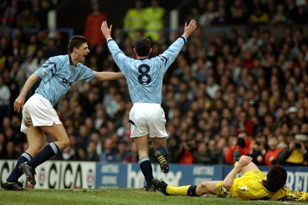 Mike Sheron and Niall Quinn of Manchester City