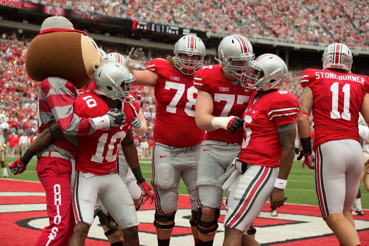 September 8, 2012; Columbus, OH, USA; The Ohio State Buckeyes and mascot Brutus Buckeye celebrate a touchdown run by quarterback Braxton Miller (5) against the UCF Knights at Ohio Stadium.  Mandatory Credit: Greg Bartram-US PRESSWIRE