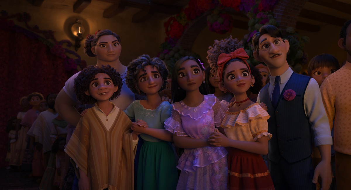 some of the Madrigal family standing side by side and looking at something