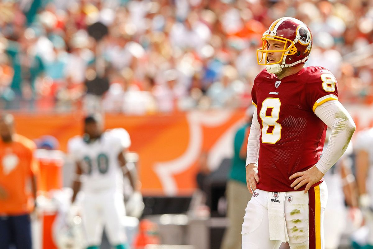 MIAMI GARDENS, FL - NOVEMBER 13:  Rex Grossman #8 of the Washington Redskins looks on during a game against the Miami Dolphins at Sun Life Stadium on November 13, 2011 in Miami Gardens, Florida.  (Photo by Mike Ehrmann/Getty Images)