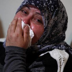 A relative mourns for Ali Shaaban, a television cameraman working for Al-Jadeed TV who was shot dead on the Lebanon-Syria border, at the family's home in Beirut, Lebanon, Monday, April 9, 2012. Shaaban was killed when the channel's film crew came under fire in the border area of Wadi Khaled, the channel's head of news said.