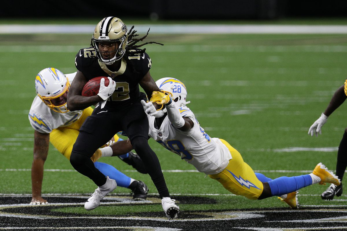 Marquez Callaway #12 of the New Orleans Saints is tackled by Brandon Facyson #28 of the Los Angeles Chargers during their NFL game at Mercedes-Benz Superdome on October 12, 2020 in New Orleans, Louisiana.