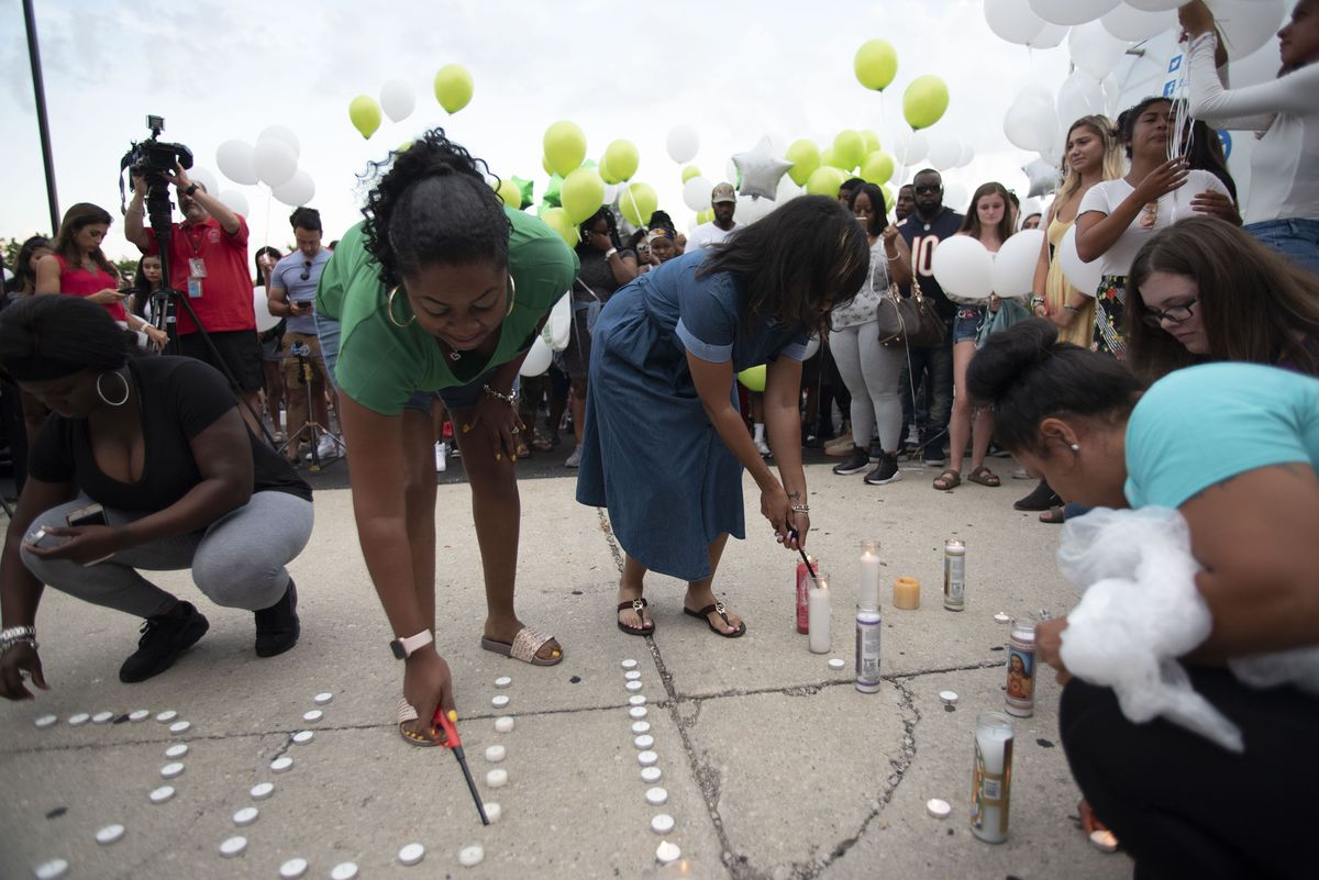 Family and friends of Sincere Ash light candles at a vigil for Ash at Lane Tech College Prep on August 9, 2018 in Chicago, IL.   Colin Boyle/Sun-Times