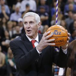 Former Utah Jazz coach Jerry Sloan has his banner unveiled in his honor during halftime of a Utah Jazz game in Salt Lake City Friday, Jan. 31, 2014.