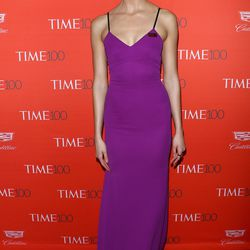 Karlie Kloss wears a purple Victoria Beckham dress, in honor of Prince.