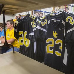 With their jerseys hanging nearby, Union High School football players in Roosevelt attend a meeting Wednesday, Sept. 25, 2013. Some players were told they wouldn't be playing in Friday's homecoming game. The football coaches at Union High in Roosevelt have taken a stand against poor performance in the classroom and bullying outside the classroom, including disrespect of teachers and students.