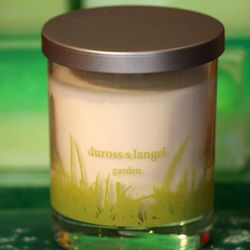 "Duross & Langel's <a href=""http://www.durossandlangel.com/7-oz-garden-collection/493-arugula-mint-7oz-garden-candle.html"">Arugula Mint Garden Candle</a> ($23) is made within the Midtown Village boutique's second-floor soap kitchen."