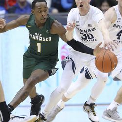 Brigham Young Cougars guard TJ Haws (30) and San Francisco Dons guard Jamaree Bouyea (1) compete for the ball in Provo on Saturday, Feb. 8, 2020.
