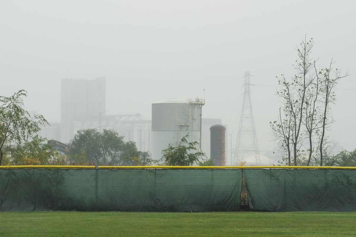 General Iron's car and metal shredding facility, which is under construction, near South Burley Avenue and East 116th Street in the Southeast Side, is seen in the background from a baseball field on East 110th Street and South Mackinaw Avenue Tuesday morning, Oct. 27, 2020.