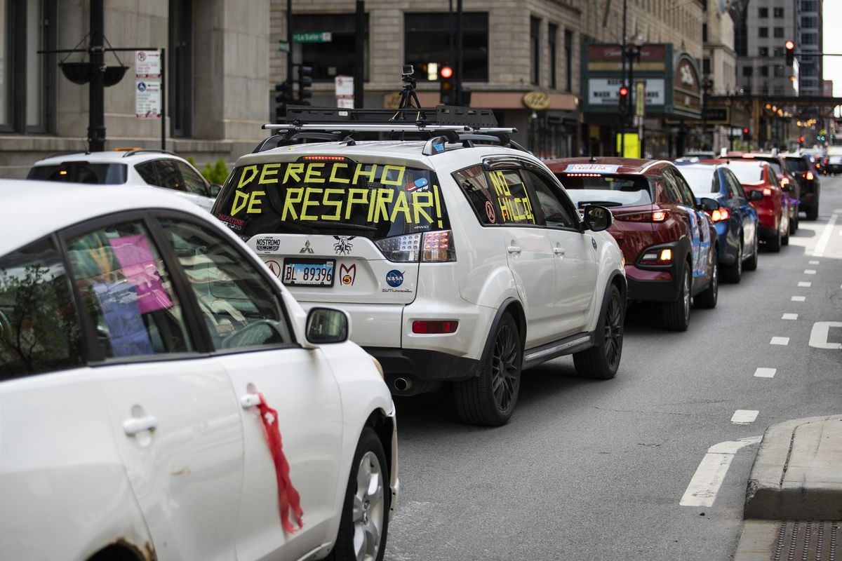 More than a hundred vehicles circle City Hall and the Thompson Center in the Loop as protesters honk their horns and rally for a range of issues, such as universal health care and immigration reform, during the coronavirus pandemic, Thursday afternoon, May 7, 2020. United Working Families organized the protest with dozens of community groups, which came together as the Right to Recovery Coalition.   Ashlee Rezin Garcia/Sun-Times