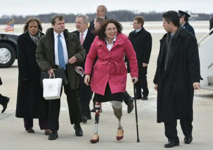 Rep. Tammy Duckworth, D-IL, walks across the tarmac upon arrival at Abraham Lincoln Capital Airport in Springfield, Illinois on February 10, 2016, after arrival with US President Barack Obama on Air Force One.  AFP / Getty Images